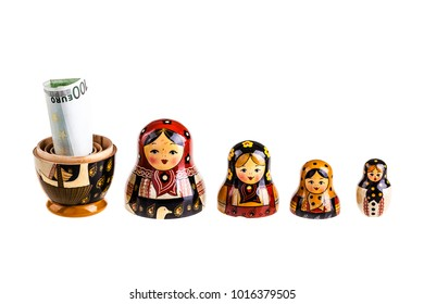 Russian doll with euro inside isolated on white background