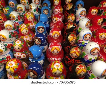 Russian doll. Moscow princess Doll. Painted Wooden dolls. Beautiful princess. Famous Russian souvenirs. Group of Colorful Russian traditional dolls. Popular handmade dolls of wood at art exhibition.