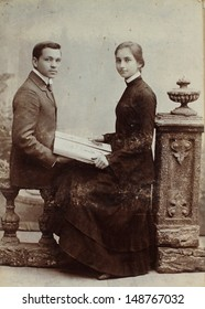 RUSSIAN EMPIRE - CIRCA 1910:Vintage photo shows young man and woman. Nostalgic picture. Circa 1910. Russian Empire, beginning of 20th century.