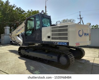 Russian excavator RM-Terex in the parking lot for special vehicles, Krasnodar region, Russia, September 5, 2018. Tracked hydraulic digger with a metal bucket for digging the earth, forestry work