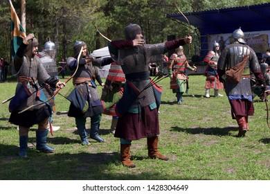 "Russian Federation, Khanty-Mansi Autonomous Okrug – Yugra, Surgut, the Sayma park, June 9, 2019: Historical event ""Mangazeyskiy khod"". Reenactors depicting 16th century tatar archers shooting arrows."