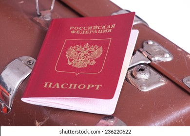 Russian Federation's Passport on an old suitcase