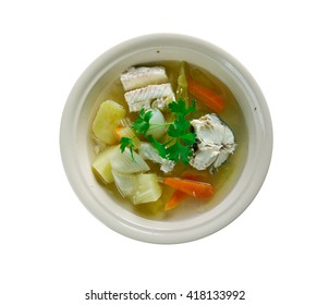 Russian fish soup - royal Ukha. with cod and sturgeon in the chicken broth