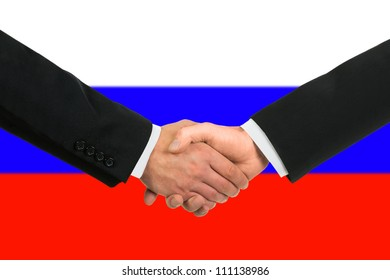 The Russian flag and business handshake