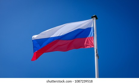 Russian flag fluttering against the blue sky