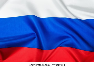 Russian flag made of silk Close-up background