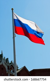 Russian flag on  background of blue sky