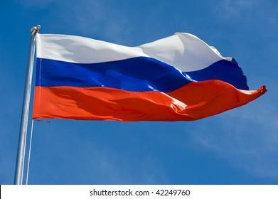 russian flag on a pole against blue sky