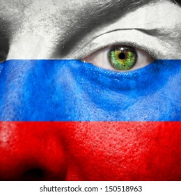 Russian flag painted on mans face to support his country Russia