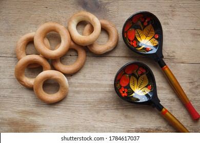 Russian folk background with Khokhloma painting spoons and bublik on wooden, place for text  - Shutterstock ID 1784617037