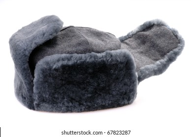 Russian fur hat with ear-flaps isolated on white