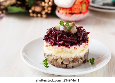 Russian herring salad on a white plate for holiday