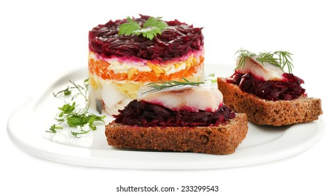 Russian herring salad  and sandwiches on plate isolated on white