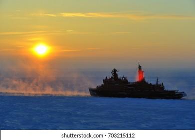 Russian icebreaker in foggy ice canal.