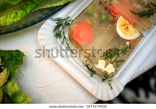 Russian jellied meat dish-jellied meat on a festive Christmas table. View from above