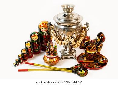 Russian khokhloma, traditional wood painting handicraft souvenirs, matryoshka nesting dolls and samovar for tea.