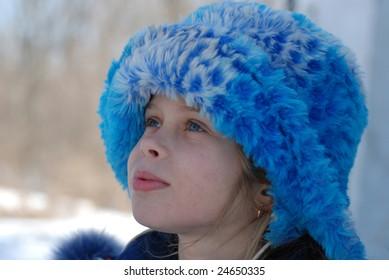 Russian little girl in fur cap, Siberia