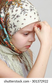 russian little girl in traditional scarf