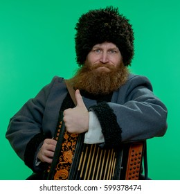 Russian man with beard wearing a hat with garmon