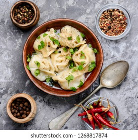 Russian meat dumplings pelmeni on rustic background.Russian pelmeni