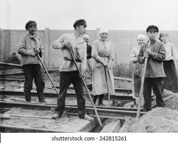 Russian men and women railroad track workers on the job in Petrograd, 1922. The Bolsheviks promoted the ideal of women's equality, a novel idea at the time, and one that was imperfectly implemented.