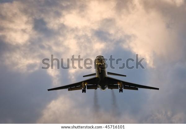 Russian midrange airplane TU with glass nose, preparing for landing