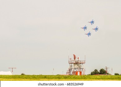 """Russian military jet fighters su-30 sm Flanker-C. Overflight of the flying group """"rhombus"""" over the aerodrome with echolocation."""
