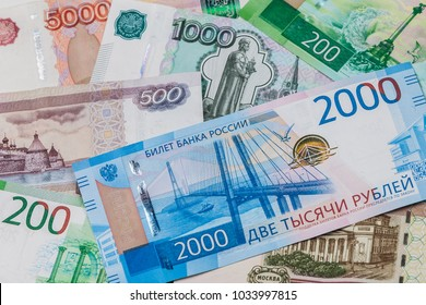 Russian money background. New 2000 and 200 rubles, old banknotes in denominations of 100, 500, 1000 and 5000 Russian rubles. Ruble banknotes without serial numbers.