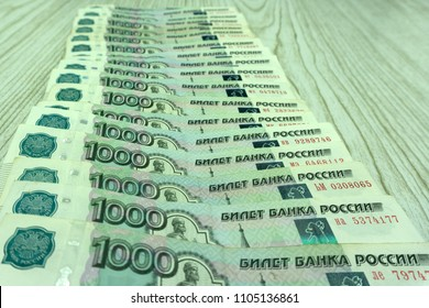 Russian money background. New 2000 and 200 rubles, old banknotes in denominations of 100, 500, 1000 and 5000 Russian rubles. Ruble banknotes without serial numbers