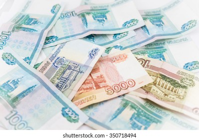 Russian money background. Ruble banknotes of different denominations closeup