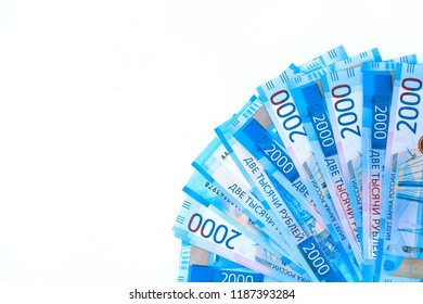 Russian money banknotes currency rouble on white isolated background. in nominal value of two thousand. New tickets bank Russia. Close up. Rich concept