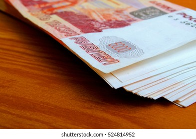 Russian money close up on a wooden table.
