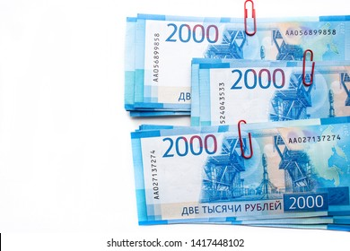 Russian money on a white background. New banknotes of two thousand rubles