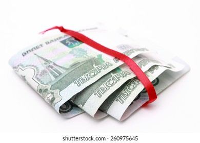 russian money and red ribbon