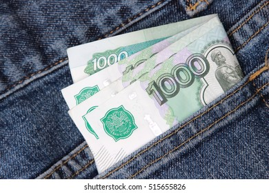 Russian money roubles in blue jeans pocket as a top view image