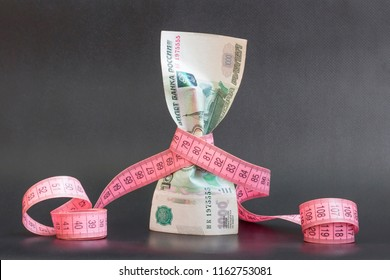 Russian money rubles with measuring tape. Symbol of inflation. Russian crisis: fall of rus rubles. Currency depreciation. Money concept.