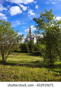 Russian (Moscow) orthodox church with summer trees and blue sky