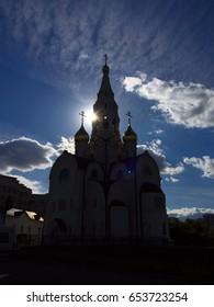 Russian Moscow Orthodox Church under dramatic sky.