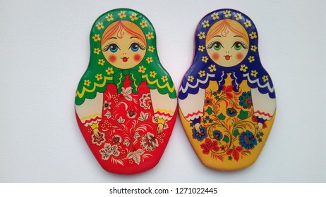 Russian multi-colored nesting dolls on a white background