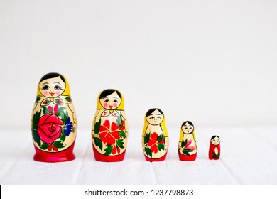 Russian national nesting dolls on a white background