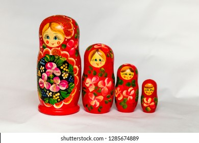 Russian nesting dolls lined up, close-up on white background
