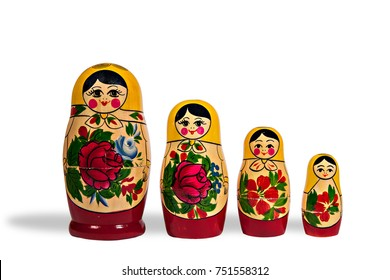 Russian nesting dolls, on a white background, old, with chips and stains. Isolated. Vertically