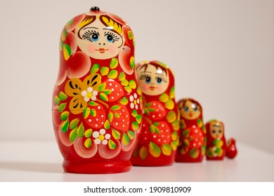 Russian nesting dolls standing on white background