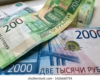 Russian new banknotes 200 rubles, 2000 rubles and old banknotes 1000 rubles. Close-up. Cash, currrency, banknotes bank Russia. Finance and business concept.