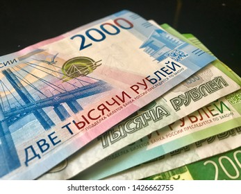 Russian new banknotes 200 rubles, 2000 rubles and old banknotes 1000 rubles. Close-up. Scattered fan banknotes. Cash, currrency, banknotes bank Russia. Finance and business concept.