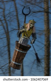Russian old witch baba-yaga with witch's broom in a mortar flies