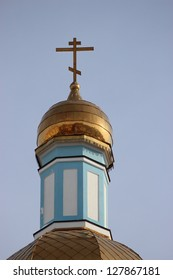 Russian Orthodox Church. Dome and a cross on a background of blue sky