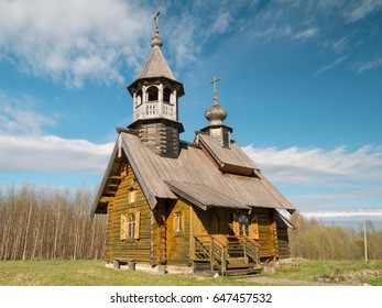 Russian orthodox wooden church against blue sky