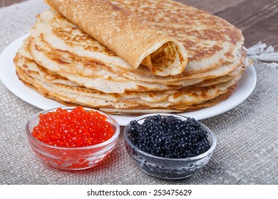 Russian pancakes - blini with red and black caviar.