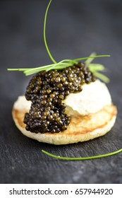 Russian Pancakes  Blini with Sour Cream and Black Caviar Close Up. Holidays Appetizers, Party Appetizers, Luxury Appetizers
